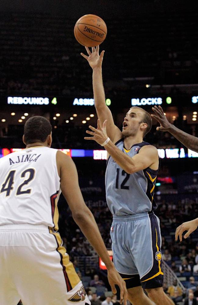 Memphis Grizzlies guard Nick Calathes (12) scores over New Orleans Pelicans center Alexis Ajinca (42) in the first half of an NBA basketball game in New Orleans, Wednesday, March 12, 2014