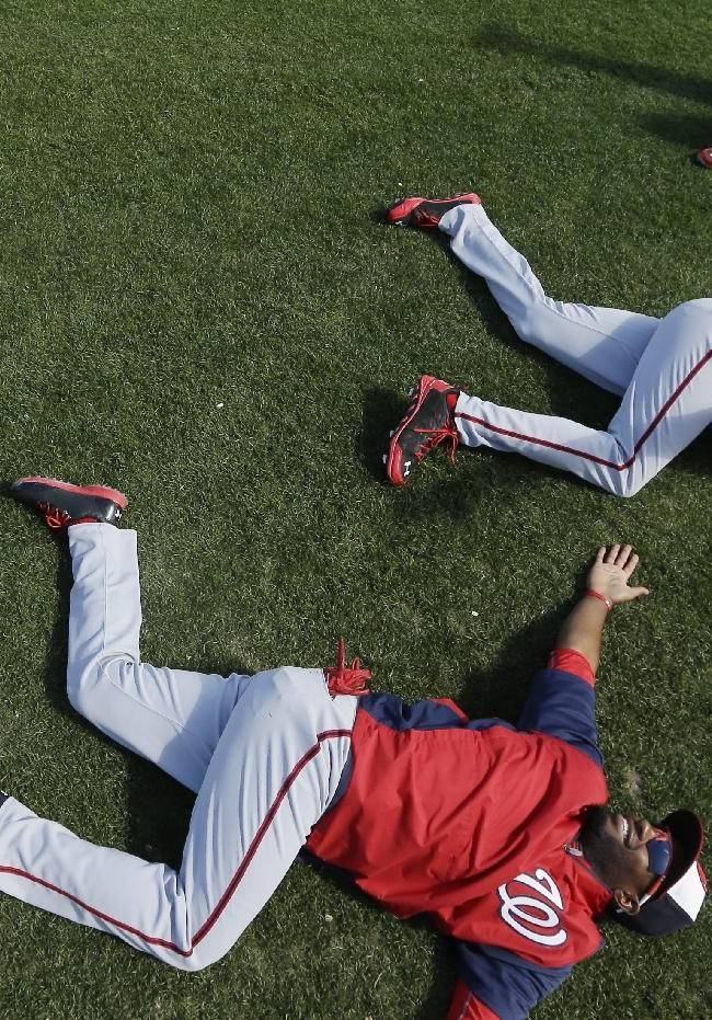 The Washington Nationals stretch before batting practice of a spring exhibition baseball game against the Houston Astros in Kissimmee, Fla., Sunday, March 16, 2014