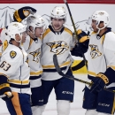 Nashville Predators' Seth Jones (3) celebrates with teammates Mike Ribeiro(63), Craig Smith (15) and Filip Forsberg (9) after a Predators goal against the Montreal Canadiens during the second period of an NHL hockey game Tuesday, Jan. 20, 2015, in Montrea
