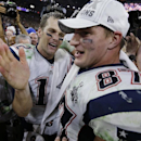 New England Patriots quarterback Tom Brady, left, celebrates with teammate Rob Gronkowski (87) after the NFL Super Bowl XLIX football game against the Seattle Seahawks Sunday, Feb. 1, 2015, in Glendale, Ariz. The Patriots won 28-24 The Associated Press