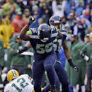 Seattle Seahawks' Cliff Avril (56) celebrates after sacking Green Bay Packers' Aaron Rodgers (12) during the second half of the NFL football NFC Championship game Sunday, Jan. 18, 2015, in Seattle The Associated Press