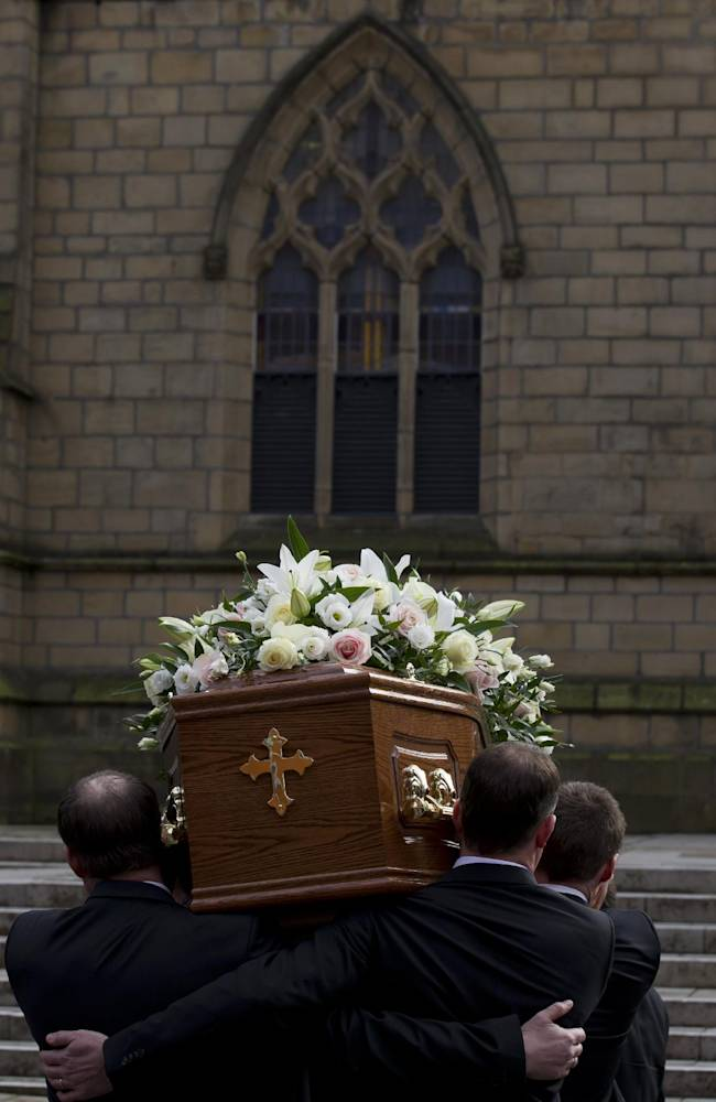The coffin bearing the late Sir Tom Finney is carried into Preston Minster for a funeral service for the former Preston and England player, Preston, England, Thursday Feb. 27, 2014. The 91-year-old former England and Preston North End winger died on  February 14 and was famous for his loyalty to his league club, Preston North End for whom he made 569 first-class appearances and for his performances in the English national side. AP Photo/Jon Super)