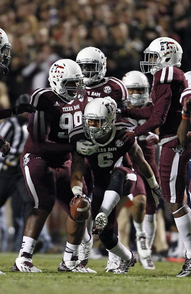 Texas A&M's Noel Ellis (6) celebrates his fumble recovery during the first half of an NCAA college football game against UTEP, Saturday, Nov. 2, 2013 in College Station, Texas