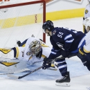 Nashville Predators goaltender Pekka Rinne (35) robs Winnipeg Jets' Mark Scheifele (55) of a goal as Predators' Olli Jokinen (13) and Calle Jarnkrok (19) follow up during the third period of an NHL hockey game Friday, Oct. 17, 2014, in Winnipeg, Manitoba