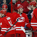 Carolina Hurricanes' Jordan Staal (11) congratulates teammate Patrick Dwyer, center, on his goal during the second period of an NHL hockey game in Raleigh, N.C., Tuesday, Nov. 12, 2013. Hurricanes won 2-1 The Associated Press