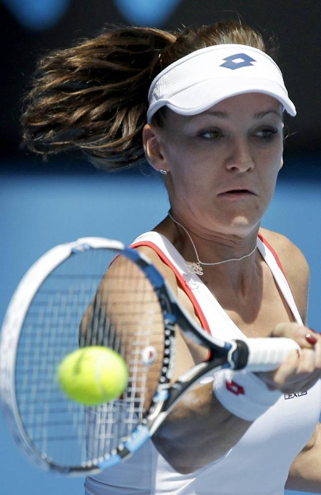 On song: Djokovic, Williams sisters advance at Aussie Open
