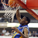 Vaux's Rysheed Jordan, top, dunks behind Johnsonburg's Mitch Holmberg in the second half of the PIAA Class A Boys Basketball championship game on Friday, March 22, 2013 in Hershey, Pa. Vaux won 83-63. (AP Photo/Keith Srakocic)