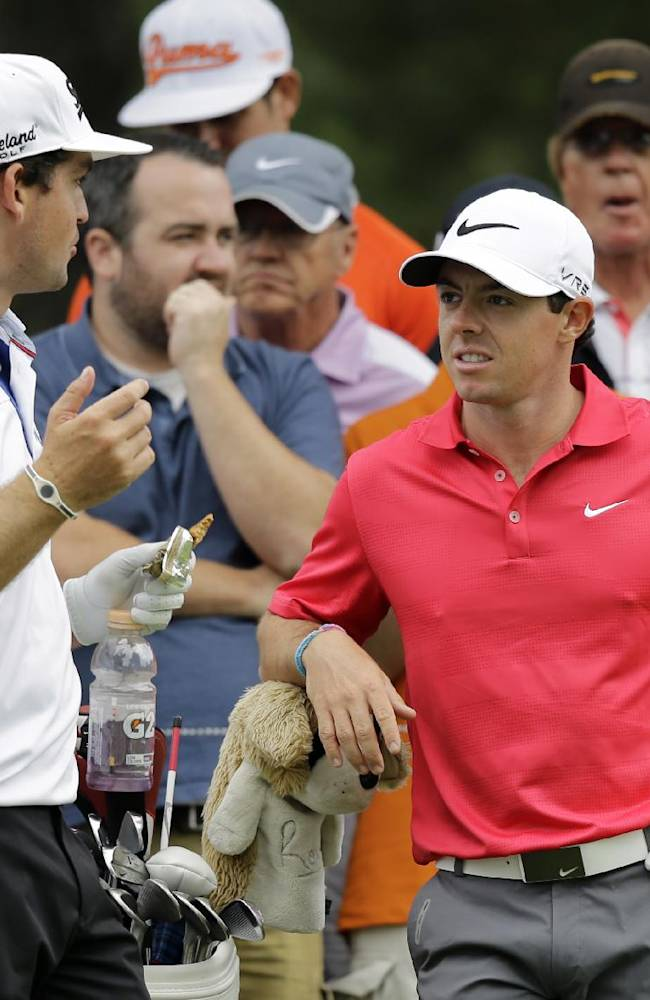 Keegan Bradley, left, talks with Rory McIlroy, from Northern Ireland, on the 12th tee during practice for the Bridgestone Invitational golf tournament Wednesday, July 30, 2014, in Akron, Ohio