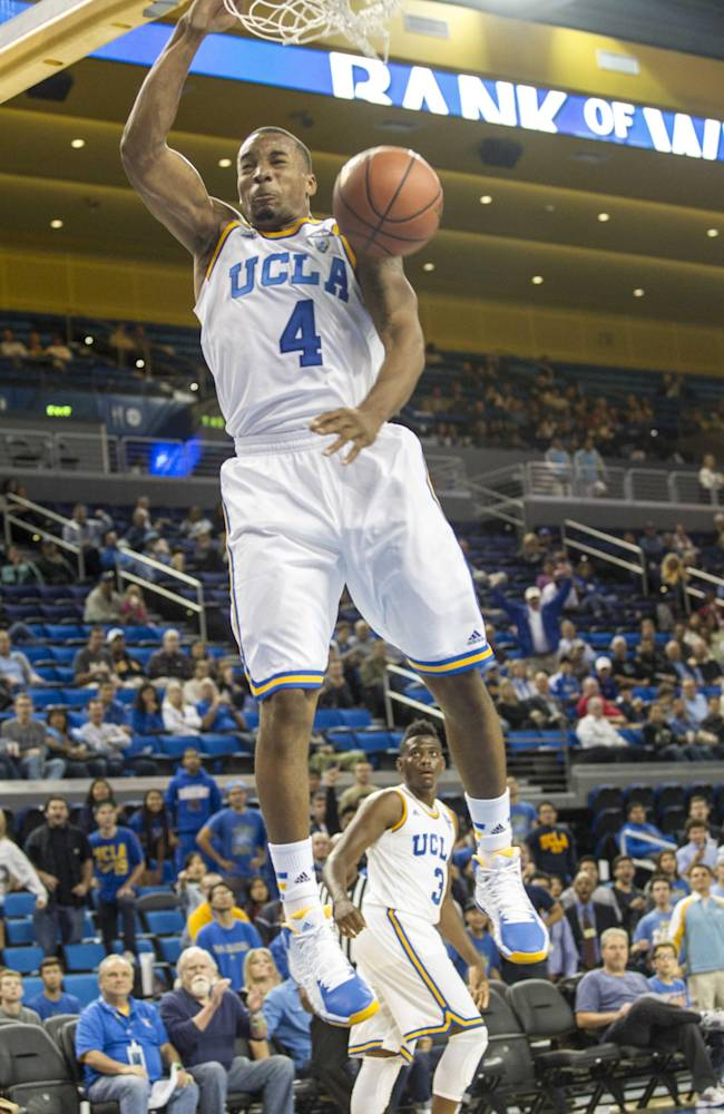 UCLA's Norman Powell #4 lam dunks against Cal State San Bernardino in the second half of an NCAA college exhibition basketball game on Wednesday, Oct. 30, 2013, in Los Angeles