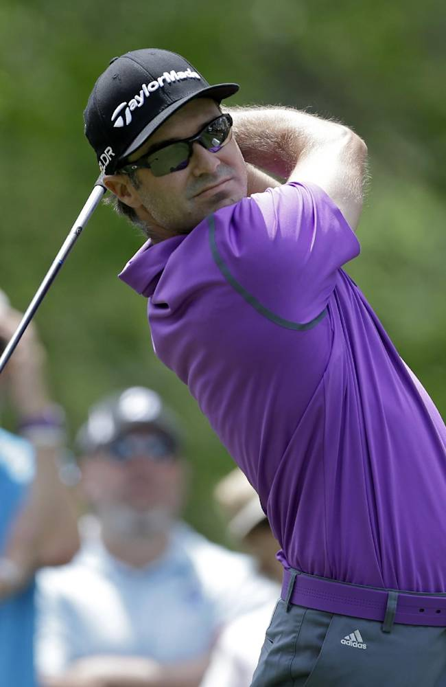 Trevor Immelman, of South Africa, watches his tee shot on the fourth hole during the first round of the Wells Fargo Championship golf tournament in Charlotte, N.C., Thursday, May 1, 2014