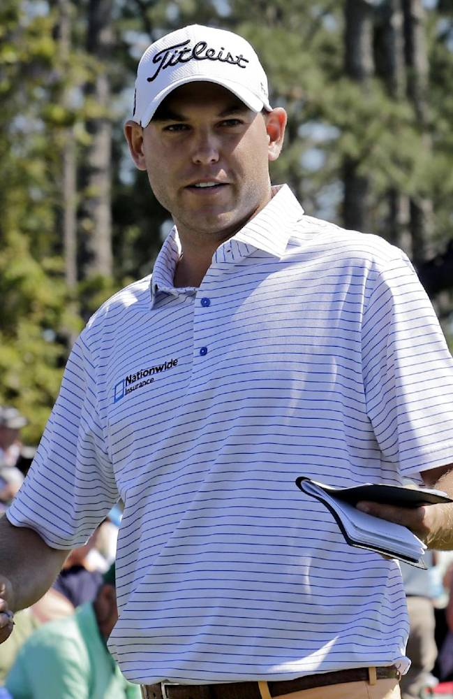 Bill Haas walks off the 18th green with his course notes after his first round of the Masters golf tournament Thursday, April 10, 2014, in Augusta, Ga