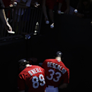 St. Louis Cardinals' Mike O'Neill, left, and Daniel Descalso, right, sign autographs for fans before the start of an exhibition spring training baseball game against the Washington Nationals, Saturday, March 8, 2014, in Jupiter, Fla The Associated Press