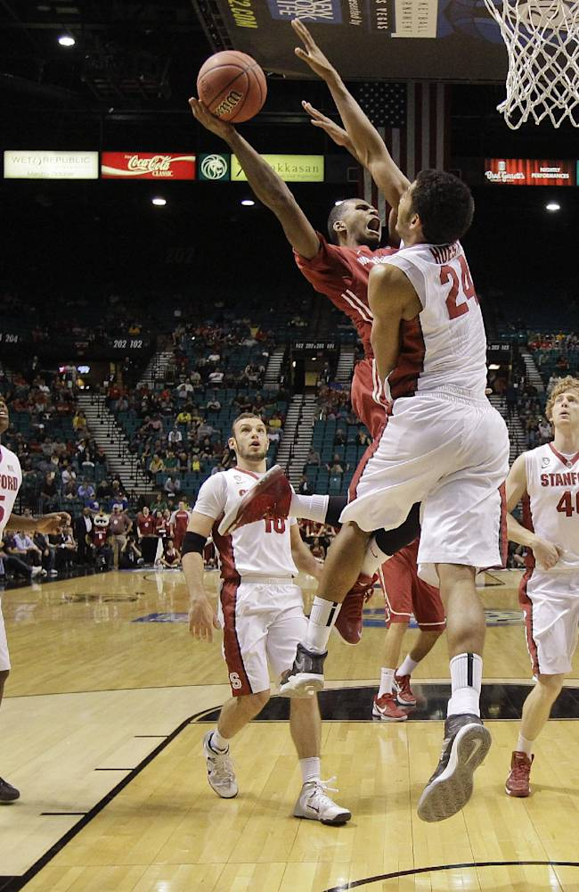 Washington State's Royce Woolridge puts up a shot against Stanford's Josh Huestis in the first half of an NCAA Pac-12 conference tournament college basketball game, Wednesday, March 12, 2014, in Las Vegas. Stanford won 74-63