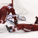 Arizona Coyotes' David Moss, right, trips up teammate Lauri Korpikoski (28), of Finland, as both end up colliding with Edmonton Oilers' Ben Scrivens, left, during the third period of an NHL hockey game Wednesday, Oct. 15, 2014, in Glendale, Ariz. The Coy