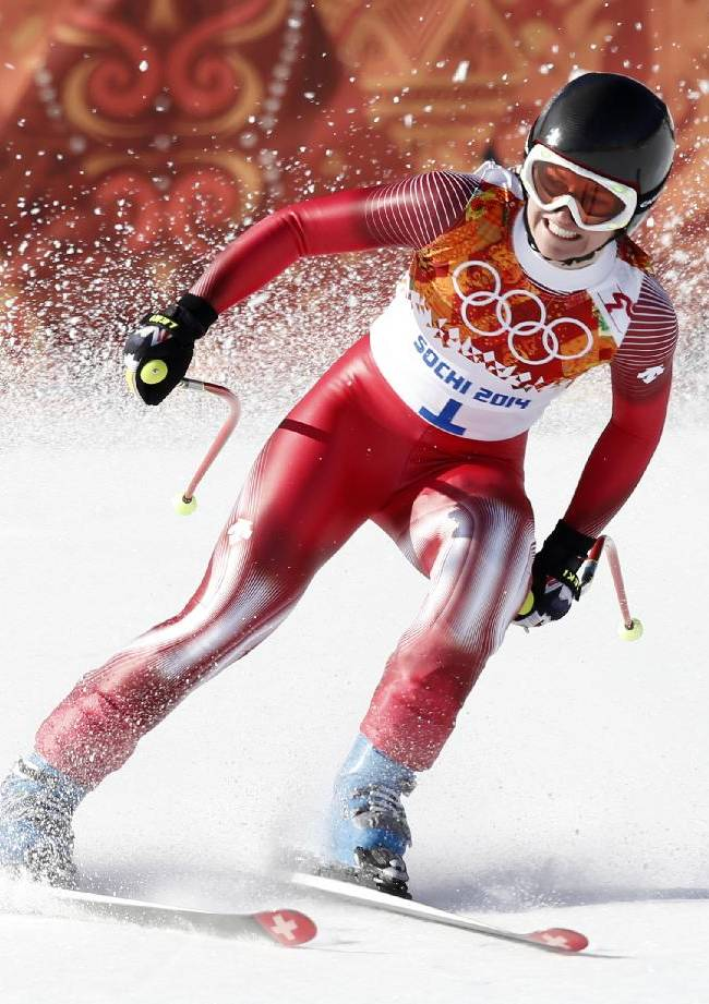 Switzerland's Fabienne Suter comes to a halt at the end of the women's downhill at the Sochi 2014 Winter Olympics, Wednesday, Feb. 12, 2014, in Krasnaya Polyana, Russia