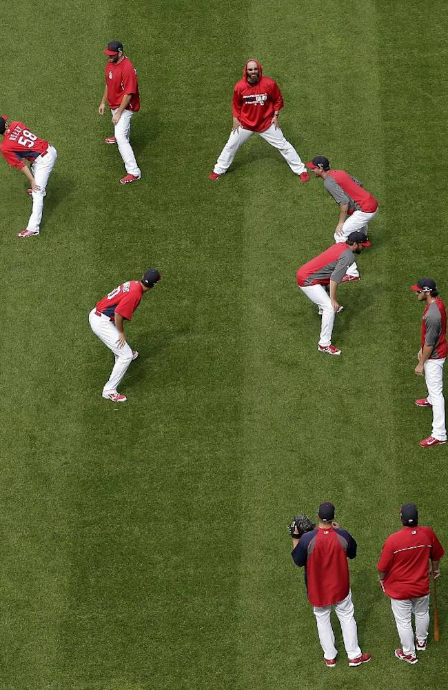 St. Louis Cardinals players stretch during a workout at Busch Stadium on Wednesday, Oct. 2, 2013, in St. Louis. Game 1 of the National League Division Series baseball playoff between the Pirates and the St. Louis Cardinals is scheduled for Thursday