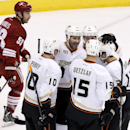 Anaheim Ducks' Dustin Penner (17) celebrates his goal against the Phoenix Coyotes with teammates Corey Perry (10), Ryan Getzlaf (15), Cam Fowler (4) and Nick Bonino, right, as Phoenix Coyotes' Derek Morris (53) skates past during the first period of an NH