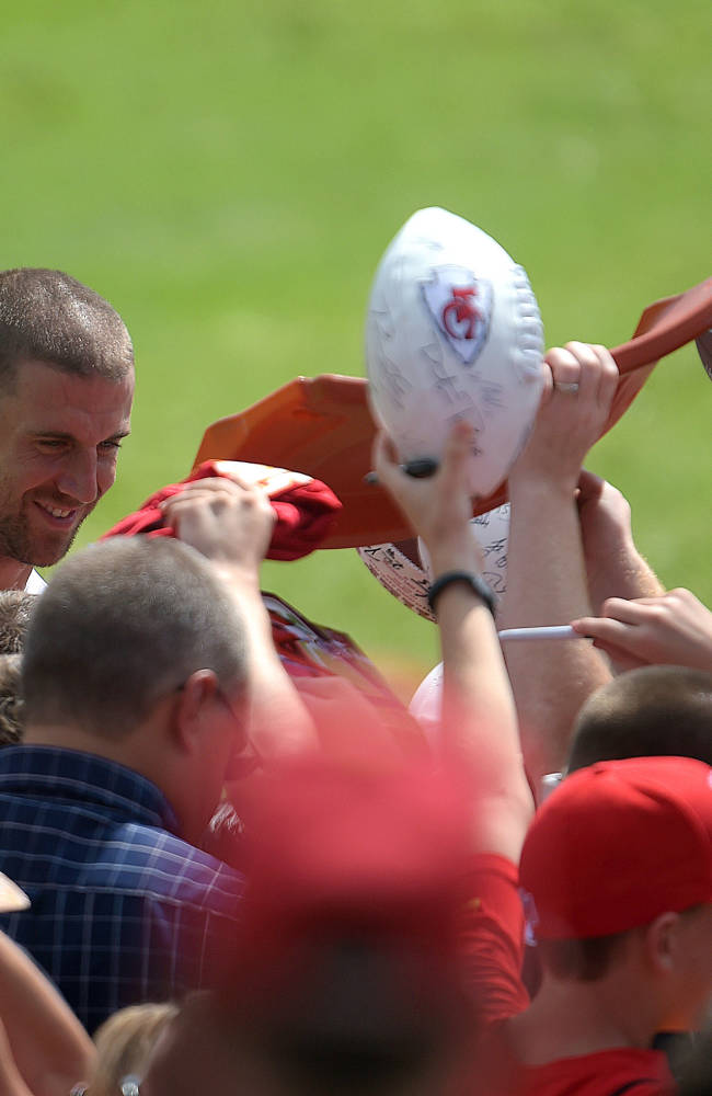 Kansas City Chiefs quarterback Alex Smith (11) signs autographs after practice Monday morning, Aug. 11, 2014, on the Missouri Western State University campus in St. Joseph. Mo