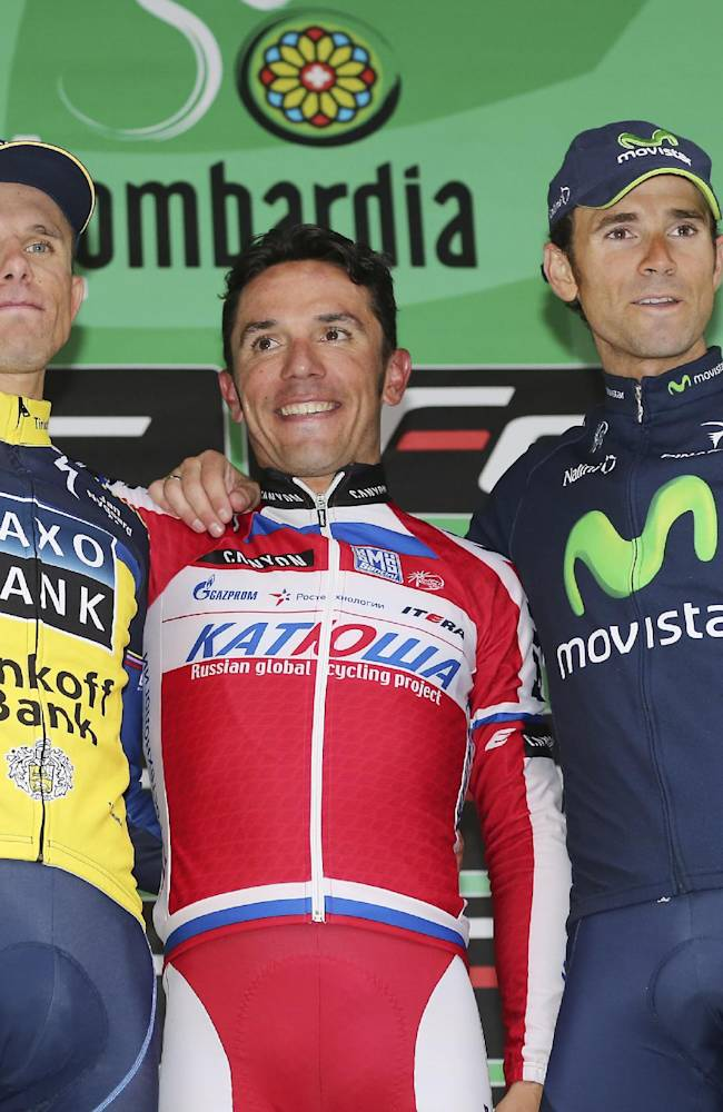 Joaquin Rodriguez, center, of Spain, winner of  the Tour of Lombardy cycling race, celebrates on the podium with second placed Alejandro Valverde, right, of Spain, and third placed Rafal Majka, of Poland, in Lecco, Italy, Sunday, Oct. 6, 2013