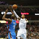 DALLAS, TX - DECEMBER 28:  Monta Ellis #11 of the Dallas Mavericks takes a shot against Serge Ibaka #9 of the Oklahoma City Thunder at American Airlines Center on December 28, 2014 in Dallas, Texas.  NOTE TO USER: User expressly acknowledges and agrees that, by downloading and or using this photograph, User is consenting to the terms and conditions of the Getty Images License Agreement.  (Photo by Ronald Martinez/Getty Images)