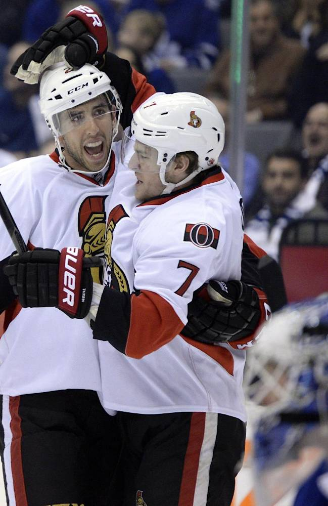 Ottawa Senators' Kyle Turris, right, celebrates his goal against the Toronto Maple Leafs with teammate Jared Cowen, left, during first-period NHL hockey game action in Toronto, Saturday, Oct. 5, 2013