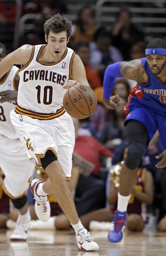 Cleveland Cavaliers' Sergey Karasev (10), from Russia, steals the ball from Detroit Pistons' Josh Smith in the fourth quarter of a preseason NBA basketball game Thursday, Oct. 17, 2013, in Cleveland. The Cavaliers won 96-84