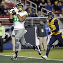 Oregon tight end Pharaoh Brown, left, catches a touchdown pass next to California cornerback Darius White during the second half of an NCAA college football game Friday, Oct. 24, 2014, in Santa Clara, Calif The Associated Press