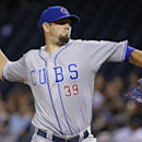 In this June 11, 2014, file photo, Chicago Cubs starting pitcher Jason Hammel delivers during the first inning of a baseball game against the Pittsburgh Pirates in Pittsburgh. A person familiar with the negotiations tells The Associated Press that right-h