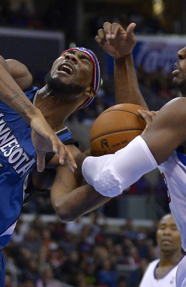 Los Angeles Clippers guard Chris Paul, right, steals the ball from Minnesota Timberwolves forward Corey Brewer during the second half of an NBA basketball game, Monday, Nov. 11, 2013, in Los Angeles. The Clippers won 109-107