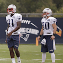 New England Patriots tight end Tim Wright (81) and wide receiver Danny Amendola (80) stand together during a stretching session before practice begins at the NFL football team's facility Thursday, Sept. 11, 2014, in Foxborough, Mass The Associated Press