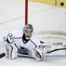 Los Angeles Kings' goalie Jonathan Quick is scored on by a shot from Calgary Flames' TJ Galiardi during first period NHL action in Calgary, Alberta, Wednesday, April 9, 2014 The Associated Press