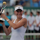 Caroline Wozniacki of Denmark holds up her trophy after her victory against Roberta Vinci of Italy in their tennis final match at the Istanbul Cup in Istanbul, Turkey, Sunday, July 20, 2014. Wozniacki overpowered second-seeded Vinci 6-1, 6-1 Sunday to win the Istanbul Cup final and clinch her first WTA title of the year.(AP Photo)