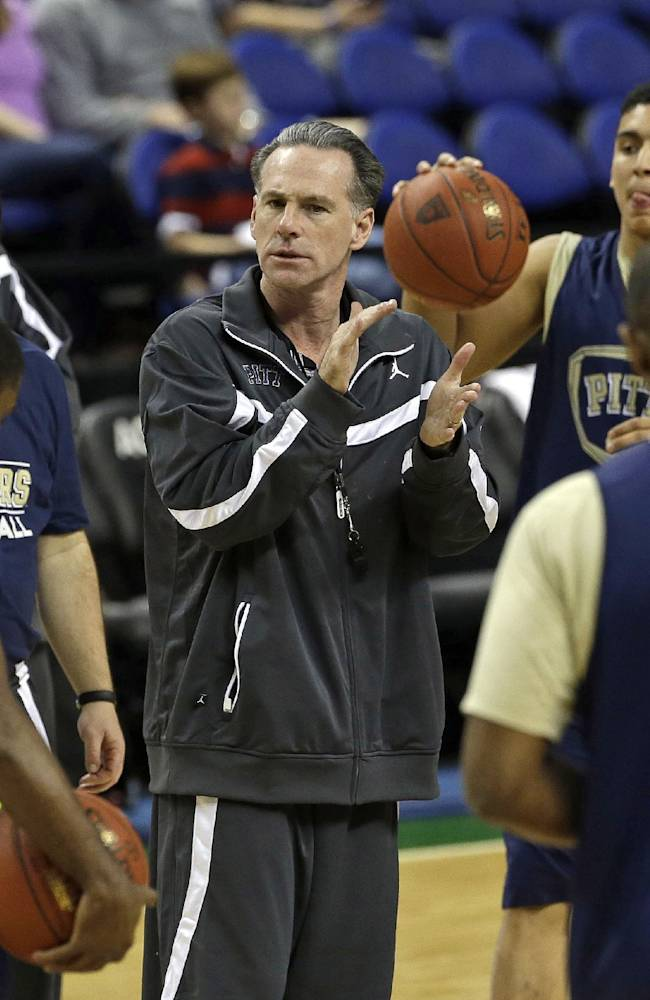 Pittsburgh coach Jamie Dixon speaks with his team during an NCAA college basketball practice for the Atlantic Coast Conference tournament in Greensboro, N.C., Tuesday, March 11, 2014