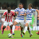 Queens Park Rangers players Steven Caulker, center, and Niko Kranjcar, right, challenge Stoke City's Victor Moses during the English Premier League soccer match at Loftus Road, London, Saturday Sept. 20, 2014