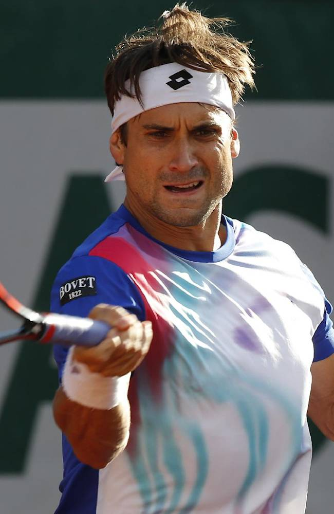 Spain's David Ferrer returns the ball to compatriot Rafael Nadal during their quarterfinal match of  the French Open tennis tournament at the Roland Garros stadium, in Paris, France, Wednesday, June 4, 2014
