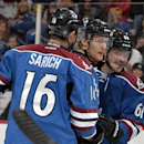 Colorado Avalanche left wing Gabriel Landeskog, center, from Sweden, is congratulated by teammates Cory Sarich (16) and Andre Benoit (61) after scoring a goal against the Minnesota Wild during the first period of an NHL hockey game Saturday, Nov. 30, 2013