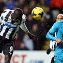 Newcastle United's Papiss Cisse, left, has a shot towards goal past Tottenham Hotspur's Kyle Walker, right, during their English Premier League soccer match at St James' Park, Newcastle, England, Wednesday, Feb. 12, 2014