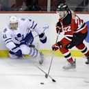 Toronto Maple Leafs' Nikolai Kulemin (41), of Russia, plays the puck as he falls in front of New Jersey Devils' Eric Gelinas (22) during the second period of an NHL hockey game Sunday, March 23, 2014, in Newark, N.J. The Devils won 3-2 The Associated Pres