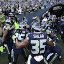 Seattle Seahawks defensive players including DeShawn Shead (35) and Richard Sherman (25) huddle before taking the field for warmups before an NFL football game against the San Francisco 49ers, Sunday, Dec. 14, 2014, in Seattle The Associated Press