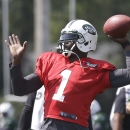 New York Jets' Michael Vick (1) throws a pass at practice during NFL football training camp Saturday, July 26, 2014, in Cortland, N.Y The Associated Press