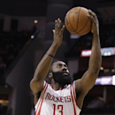Houston Rockets guard James Harden lays the ball up during the first quarter of an NBA basketball game against the New Orleans Pelicans, Saturday, April 12, 2014, in Houston The Associated Press