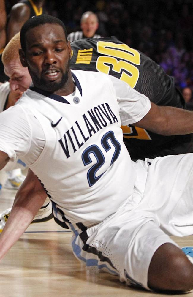 Villanova's JayVaughn Pinkston and Iowa's Jarrod Uthoff, rear, scramble for possession of a loose ball during the second half of an NCAA college basketball game in Paradise Island, Bahamas, Saturday, Nov. 30, 2013. Villanova won 88-83 in overtime