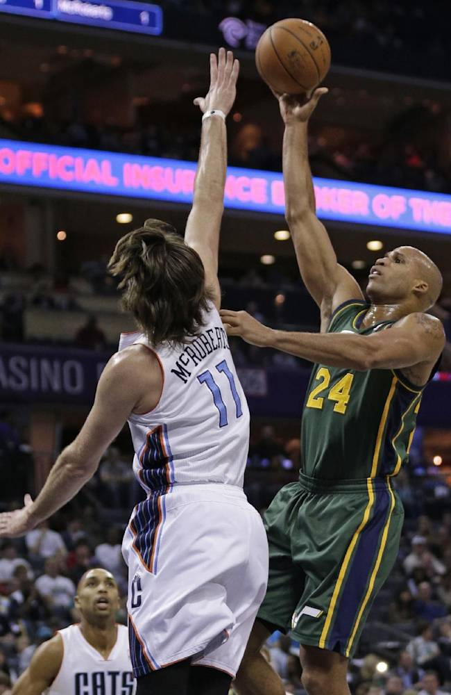 Utah Jazz's Richard Jefferson (24) shoots over Charlotte Bobcats' Josh McRoberts (11) during the first half of an NBA basketball game in Charlotte, N.C., Saturday, Dec. 21, 2013