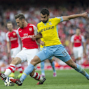 Arsenal's Aaron Ramsey, left, fights for the ball with Crystal Palace's Mile Jedinak during their English Premier League soccer match at Emirates Stadium, in London, Saturday, Aug. 16, 2014