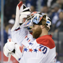Washington Capitals goaltender Braden Holtby takes his mask off after being scored on during the second period of an NHL hockey game, Saturday, Nov. 29, 2014 2014 in Toronto The Associated Press