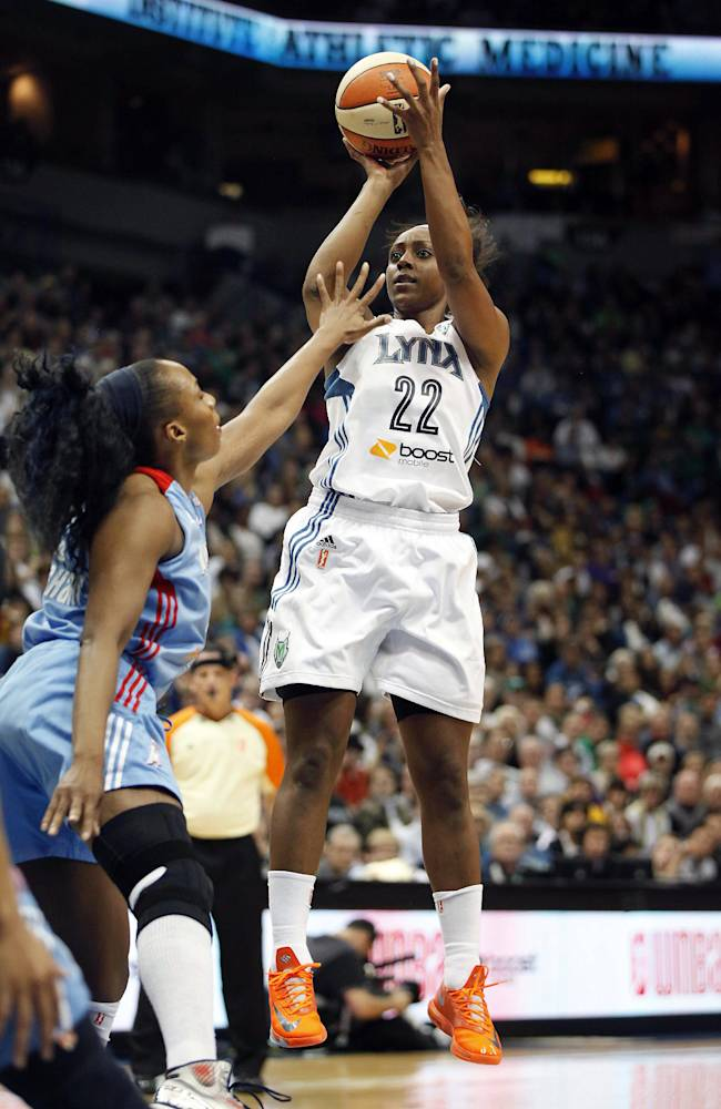 Minnesota Lynx guard Monica Wright (22) takes a shot against Atlanta Dream forward Le'coe Willingham (43) during Game 1 of the WNBA basketball finals, Sunday, Oct. 6, 2013, in Minneapolis. The Lynx won 84-59
