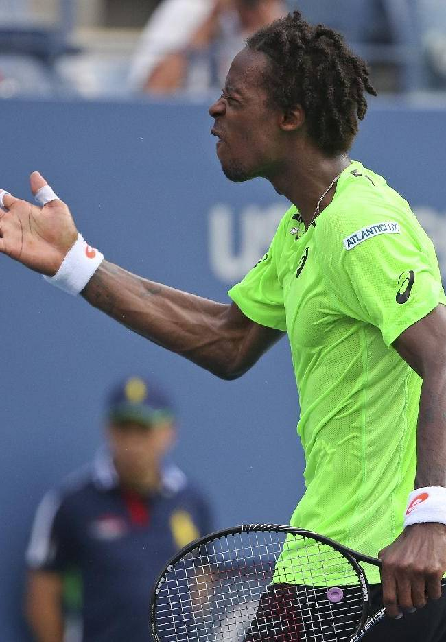 Gael Monfils, of France, reacts after defeating Grigor Dimitrov, of Bulgaria, during the fourth round of the 2014 U.S. Open tennis tournament, Tuesday, Sept. 2, 2014, in New York