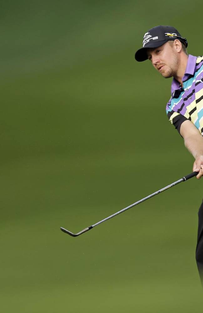 Jonas Blixt, of Sweden, chips to the 12th green during the first round of the Wells Fargo Championship golf tournament in Charlotte, N.C., Thursday, May 1, 2014