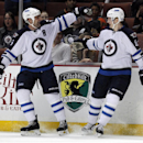 Winnipeg Jets defenseman Mark Stuart, left, celebrates a goal by defenseman Jacob Trouba, right, in the first period of an NHL hockey game against the Anaheim Ducks Monday, March 31, 2014, in Anaheim, Calif The Associated Press