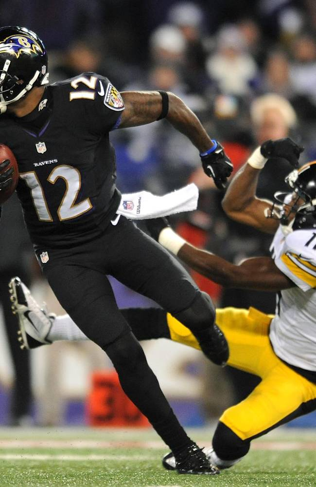 Baltimore Ravens wide receiver Jacoby Jones (12) rushes the ball past Pittsburgh Steelers' Markus Wheaton in the second half of an NFL football game on Thursday, Nov. 28, 2013, in Baltimore